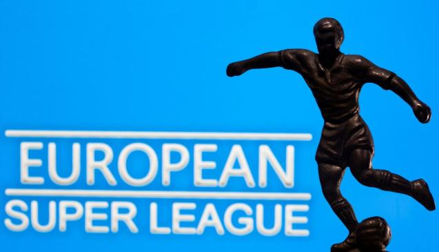"""A metal figure of a football player with a ball is seen in front of the words """"European Super League"""""""