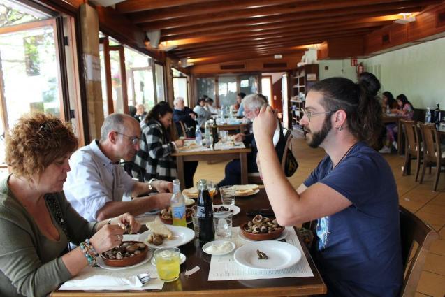 Customers eating snails at Es Cruce Restaurant, Vilafranca.