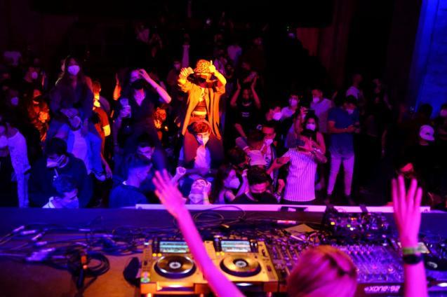Clubbers hit dance floor again as Spain trials digital COVID-19 pass