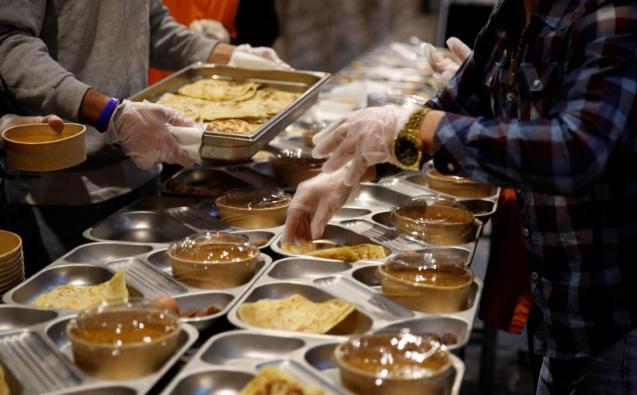 Volunteers prepare a charity Ramadan dinner