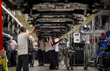Workers assemble vehicles on the assembly line of the SEAT car factory in Martorell.