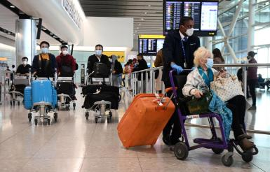 Travellers arrive at Heathrow Airport in London, Britain, 03 May 2021.
