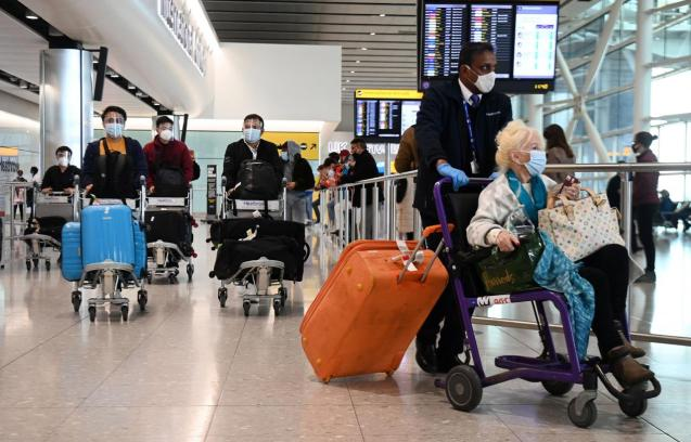 Travellers arrive at Heathrow Airport in London, Britain, 03 May 2021