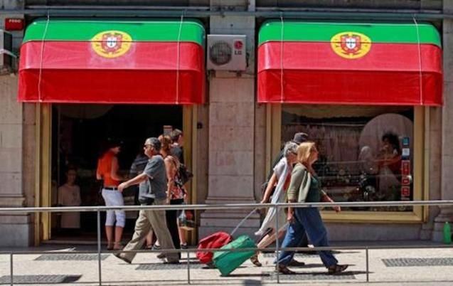 Shops in Lisbon decorated with Portuguese flag.