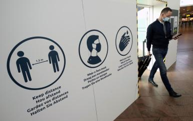 Passenger walks at Brussels international airport.