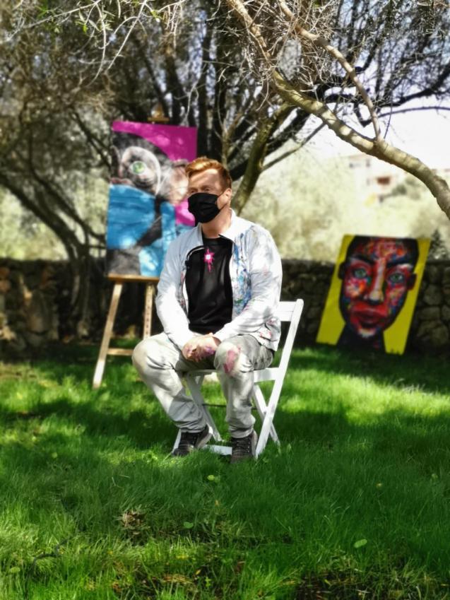 Jonas Skov with his paintings