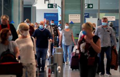 Tourists wearing face masks .