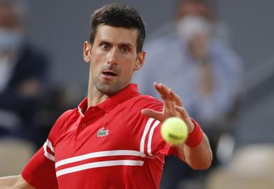 Novak Djokovic in action against Rafael Nadal.