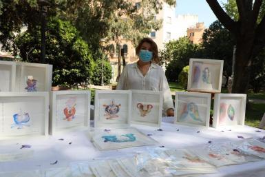An artist at Palma Mercat d'Art 'Pop Up'.