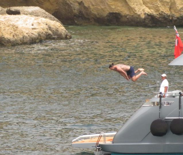 The football player jumping off the yacht in Mallorca
