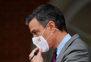Spain's Prime Minister Pedro Sanchez adjusts his mask after delivering a statement regarding pardons for jailed Catalan separatist leaders,,