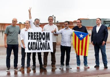 Catalan leaders Oriol Junqueras, Joaquim Forn, Josep Rull, Raul Romeva, Jordi sanchez and Jordi Cuixart gesture in front of the Lledoners prison after the Spanish government announced a pardon for those who participated in Catalonia's failed 2017 independence bid, Sant Joan de Vilatorrada, near Barcelona.