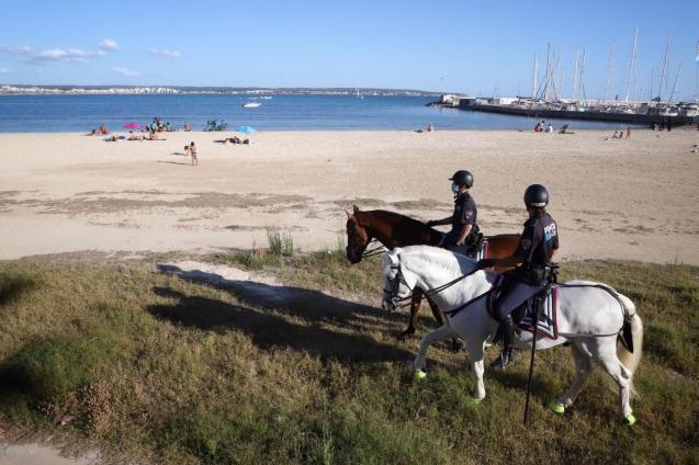 Police on horseback at Can Pastilla beach, Mallorca.