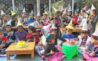 Children celebrating the 11th anniversary of the DARE home in Varanasi.