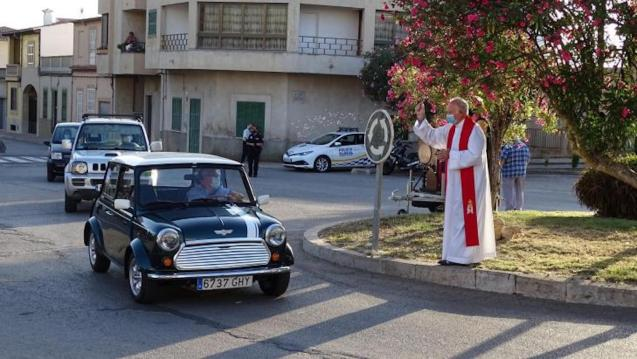 Chaplain blessing cars.