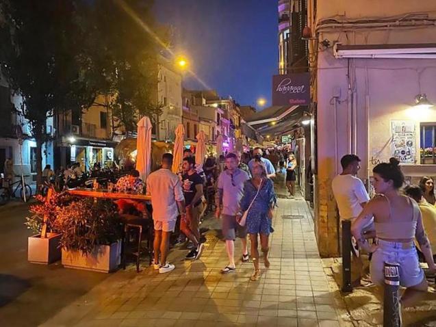 People outside a Palma bar.
