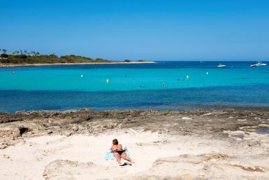 A person on a beach on the Balearic Islands.