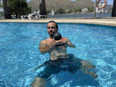 Treading Water. Tread water with your hands in the air or holding a weight. Padded weights are best in case you need to drop it, preventing pool damage.