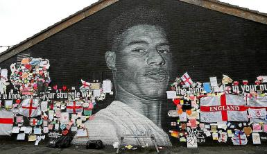 Rashford's mural is shown covered in messages of support.