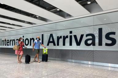 Passengers from international flights arrive at Heathrow Airport
