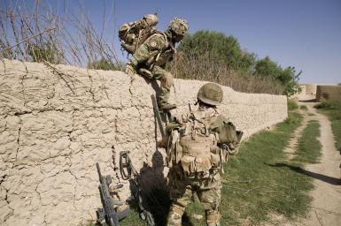 Gurkhas from C Company 1st Battalion The Royal Gurkha Rifles negotiate a wall during a mission from Patrol Base 2 in the Nahr-e Saraj region of Helmand province. The patrol was conducted with soldiers from the Afghan National Army (ANA) during Operation Moshtarak.