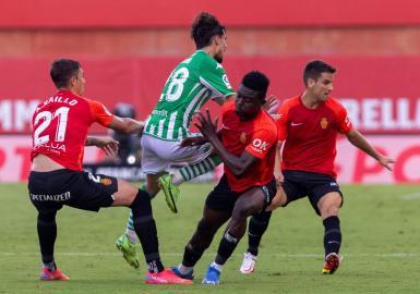 Iddrisu Baba (C), Mallorca's man of the match.