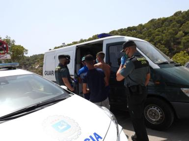 The Guardia Civil detain the migrants; the National Police then have to take charge of them.