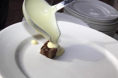 Mahon cheese in sauce