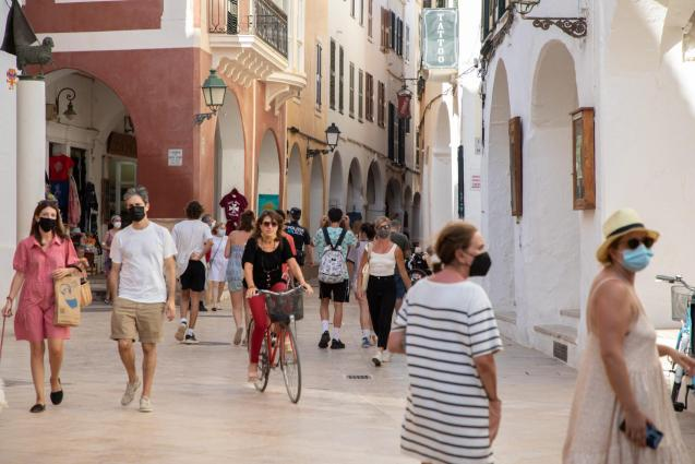 People on the street with masks in Minorca