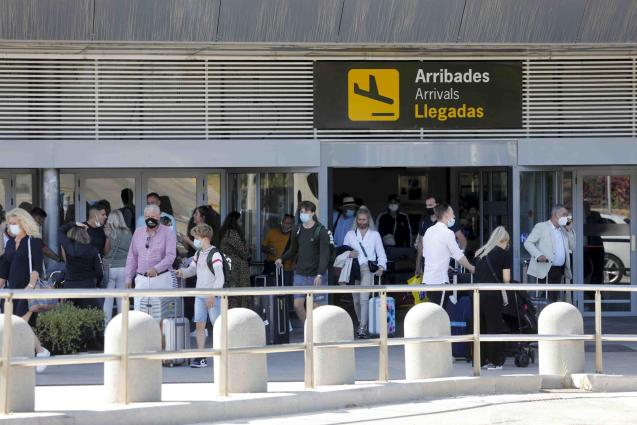 Tourists arriving at Ibiza Airport