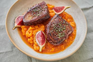 Rosemary & fennel seed glazed duck with sweet potato ragout & Fresh Figs.