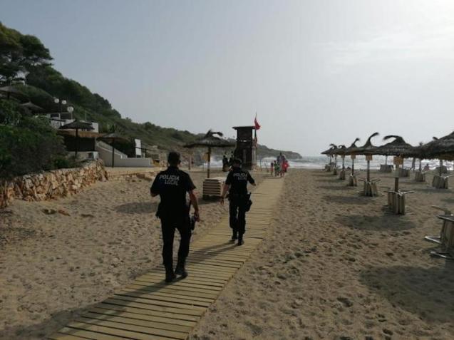 Police in Cala Mandia, Mallorca.