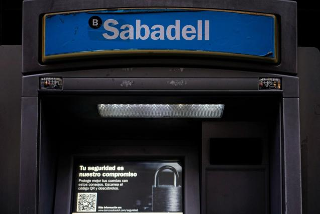 Sabadell bank's logo is seen at an ATM machine outside one of the bank's branches in Madrid