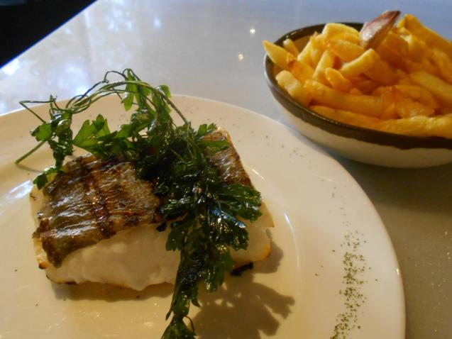 The bacalao with deep-fried parsley and chips.