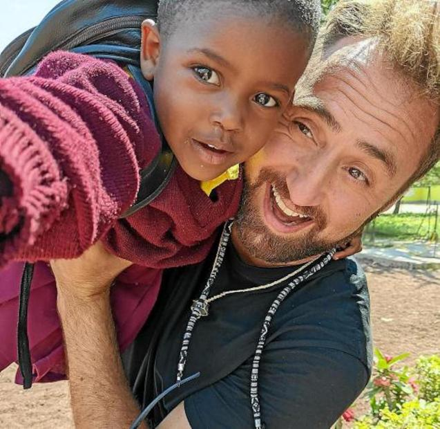 Toni Arbòs with one of the children.