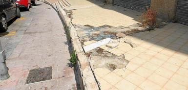 Tiles missing from pavement in Carrer Martín Ros García, Magalluf.