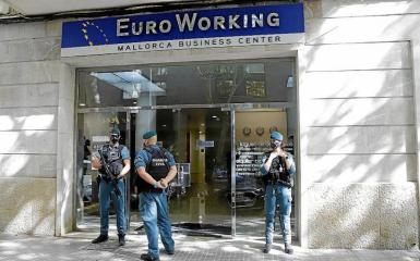 Guardia Civil Officers outside Euro Working in Palma.