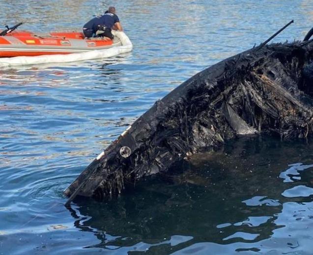 Charred remains of catamaran 'Argonaut' in Palma bay.
