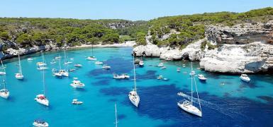 Boats in Cala Macarella, Minorca this summer.