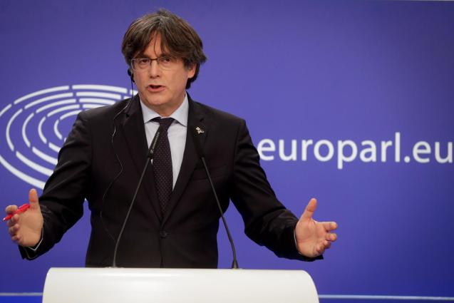 Puigdemont was living in self-imposed exile in Belgium.