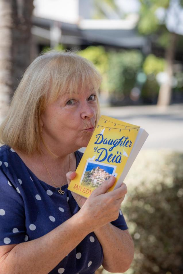 """Jan Edwards with her book """"Daughter of Deia"""""""