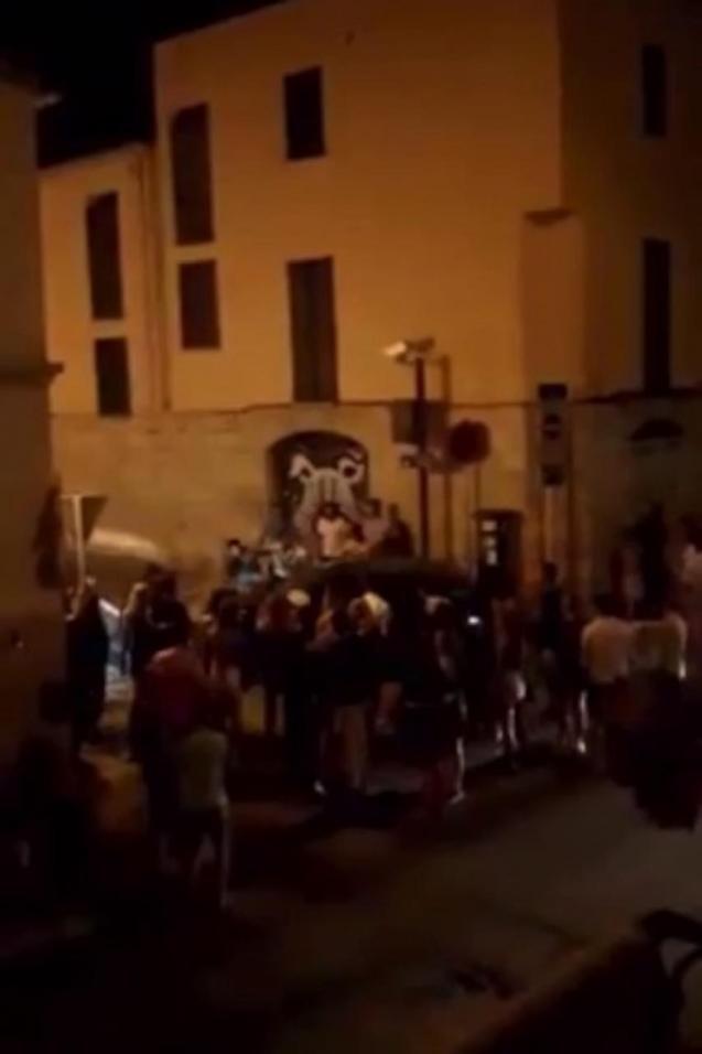 Dozens of people in Carrer de Sant Magi, Palma.