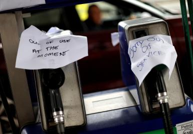 Signs show customers that fuel has run out at a petrol station.