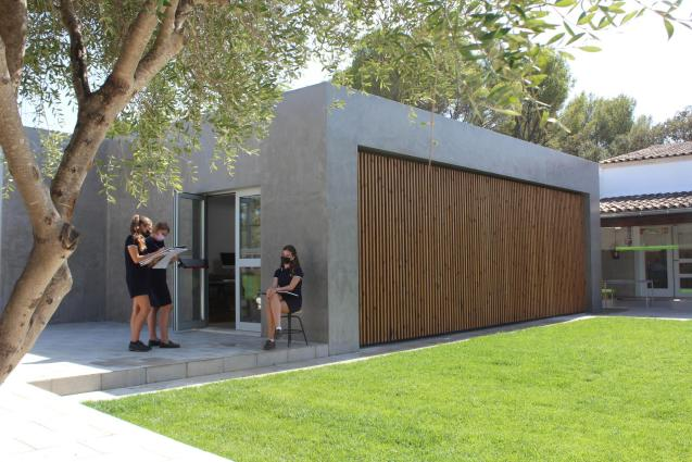 The new building has a large Art Studio with an outdoor learning area and a beautiful grass lawn in the front.