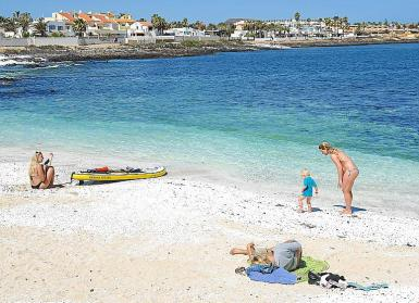 Tourists on the beach of Fuerteventura.