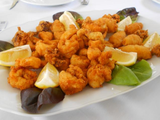 The platter of deep-fried breadcrumbed calamarines and langostinos.
