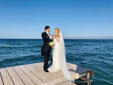 """On our wedding day on """"our pier"""" taken by our best man, Phil Flannigan."""