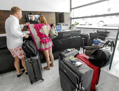 Tourists arriving at a hotel on Ibiza.