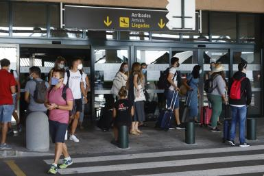 Tourists arrving to Minorca airport.