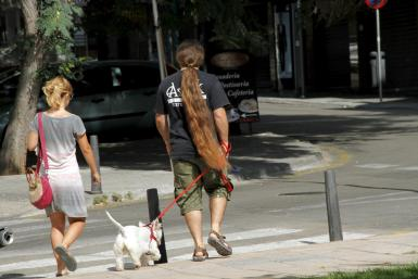 A person walking their dog in Palma.